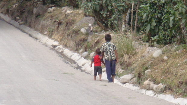 Indigenous children walking down a road El Salto Boquete Panama